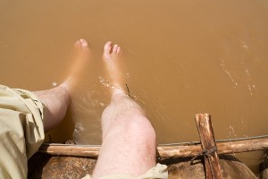 Dipping my feet in the Yellow river. The colour comes from the loess in the ground. About 10 to 20 percent of the volume is in fact mud.